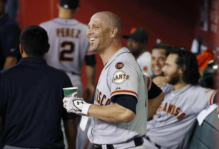 San Francisco Giants' Tim Hudson smiles in the dugout after hitting a home run against the Arizona Diamondbacks during the third inning of a baseball game Tuesday, Sept. 8, 2015, in Phoenix. (AP Photo/Ross D. Franklin) Photo: Ross D. Franklin, Associated Press