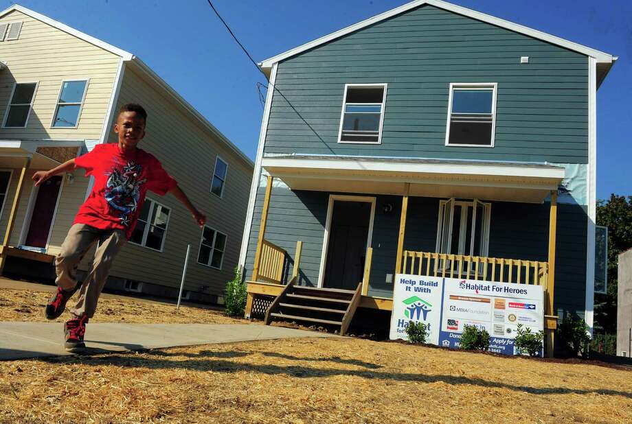 Taffie Todd, 9, in the yard of his new home on Barnum Avenue in Bridgeport, Conn., on Friday Sept. 18, 2015. Habitat for Humanity of Coastal Fairfield County held a Habitat for Heroes Dedication Ceremony for the Todd family at their future home. Amodi Todd is a veteran who helped build the house as part of Habitat of CFC's Habitat for Heroes Veteran Build Home project. Photo: Christian Abraham / Hearst Connecticut Media / Connecticut Post
