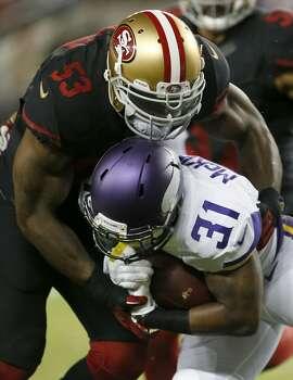 San Francisco 49ers linebacker NaVorro Bowman (53) tackles Minnesota Vikings running back Jerick McKinnon (31) during the second half of an NFL football game in Santa Clara, Calif., Monday, Sept. 14, 2015. (AP Photo/Tony Avelar)