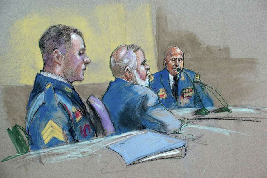 Army Sgt. Bowe Bergdahl, left, and defense lead counsel Eugene Fidell look on Friday as Maj. Gen. Kenneth Dahl is questioned during a preliminary hearing at Fort Sam Houston to determine whether Bergdahl will be court-martialed. Photo: Brigitte Woosley, FRE / FR170958 AP