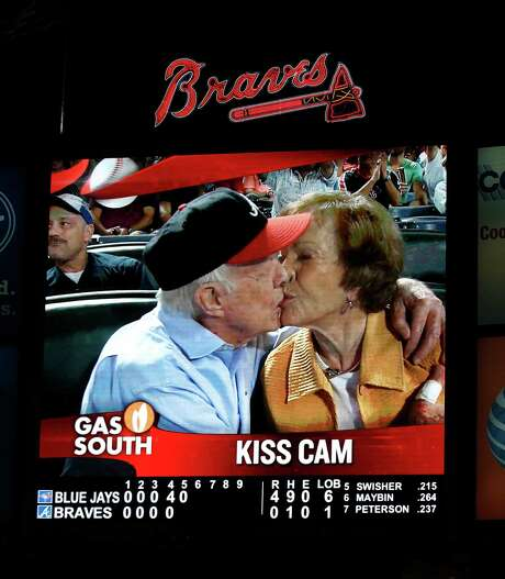 "Former President Jimmy Carter and his wife,Rosalynn, paid heed to the ""Kiss Cam.""  during a baseball game between the Atlanta Braves and the Toronto Blue Jays on Thursday, Sept. 17, 2015, in Atlanta. Carter recently announced he has cancer. (AP Photo/John Bazemore) Photo: John Bazemore, STF / AP"