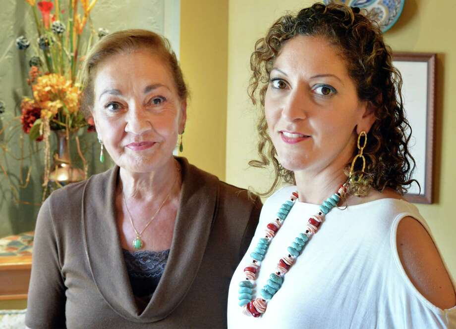 Nuhar Jaleel, right, and her mother Taj Jaleel at Nuhar's The Pilates Principle Friday Sept. 18, 2015 in Colonie, NY. They will be hosting a fundraiser for refugee Syrian children on Sunday. Instructors will give pilates and gyrotonic classes, Bodywork Professionals will give chair massages and Taj Mahal staff will be giving manicures. (John Carl D'Annibale / Times Union) Photo: John Carl D'Annibale / 00033427A