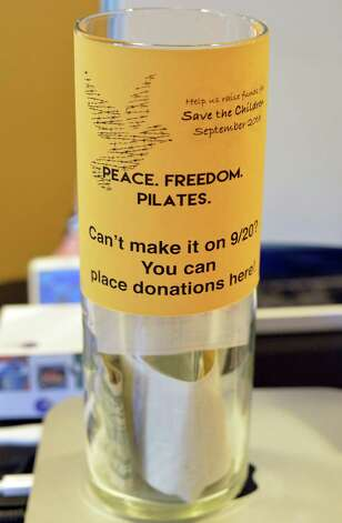 A donation jar at The Pilates Principle Friday Sept. 18, 2015 in Colonie, NY. They will be hosting a fundraiser for refugee Syrian children on Sunday. Instructors will give pilates and gyrotonic classes, Bodywork Professionals will give chair massages and Taj Mahal staff will be giving manicures. (John Carl D'Annibale / Times Union) Photo: John Carl D'Annibale / 00033427A