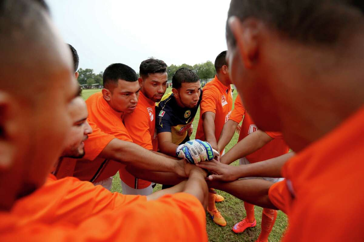 Marcos Sanchez, the goalkeeper for Paredes' team, brings the players together before the game.