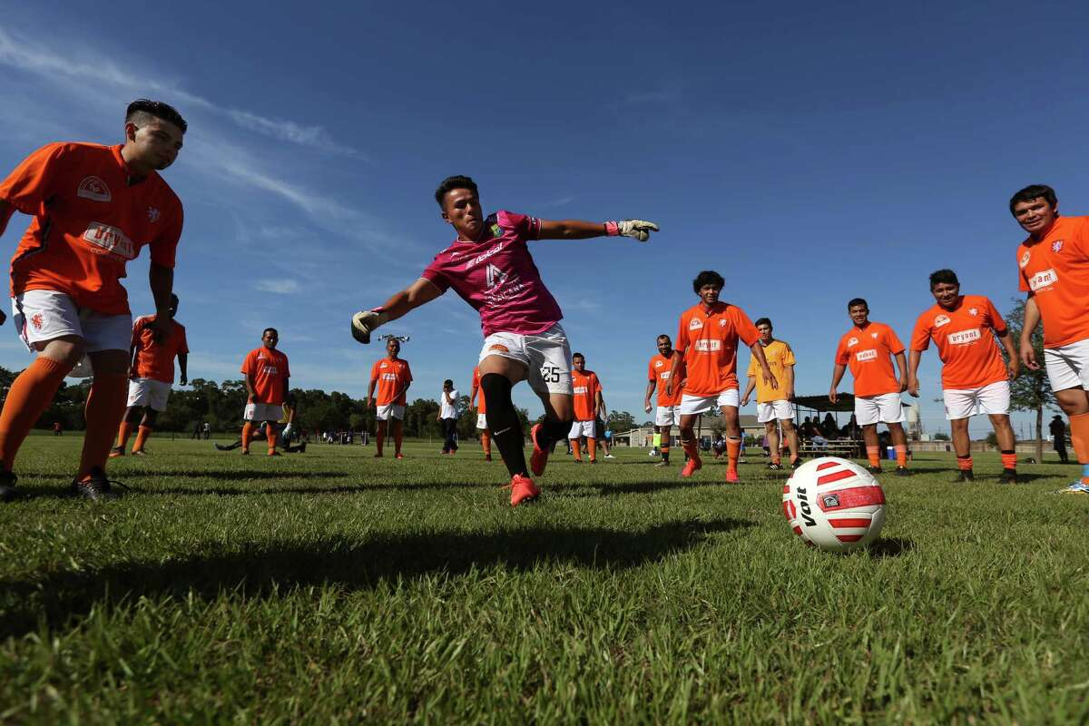 Horizon goalkeeper Emmanuel Frias, center, of Sugar Land, warms up with teammates before the start of a quarterfinal playoff soccer game against Selección Beaumont in the Copa Victor Delgadillo amateur soccer tournament at Big Tex Park in August.