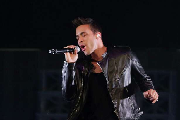 Prince Royce performs before Ariana Grande at the Toyota Center, Friday, Sept. 18, 2015, in Houston.