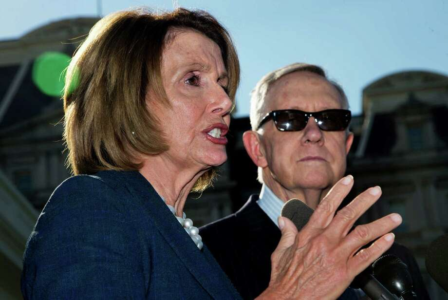 House Minority Leader Nancy Pelosi of Calif., left, accompanied by Senate Minority Leader Harry Reid of Nev., speaks to reporters outside the West Wing of the White House in Washington, Thursday, Sept. 17, 2015, after a meeting with President Barack Obama.    (AP Photo/Manuel Balce Ceneta) ORG XMIT: DCMC102 Photo: Manuel Balce Ceneta / AP