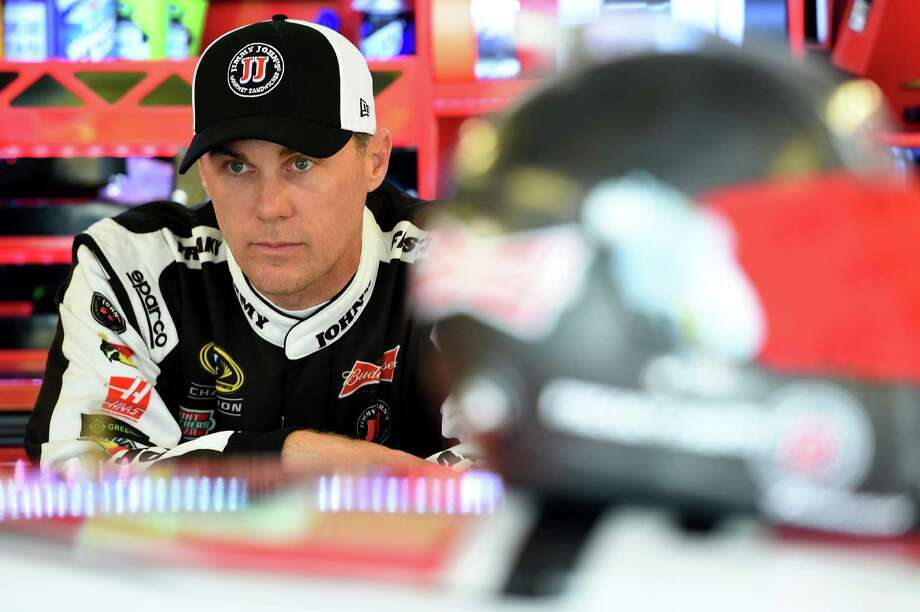 JOLIET, IL - SEPTEMBER 18:  Kevin Harvick, driver of the #4 Jimmy John's / Budweiser Chevrolet, stands in the garage area before practice for the NASCAR Sprint Cup Series myAFibRisk.com 400 at Chicagoland Speedway on September 18, 2015 in Joliet, Illinois.  (Photo by Josh Hedges/Getty Images) ORG XMIT: 532292769 Photo: Josh Hedges / 2015 Getty Images