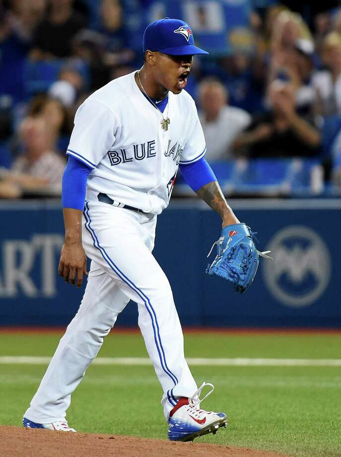 Toronto Blue Jays starting pitcher Marcus Stroman reacts after the top of the first inning of a baseball game against the Boston Red Sox on Friday, Sept. 18, 2015, in Toronto. (Nathan Denette/The Canadian Press via AP) ORG XMIT: NSD103 Photo: Nathan Denette / The Canadian Press