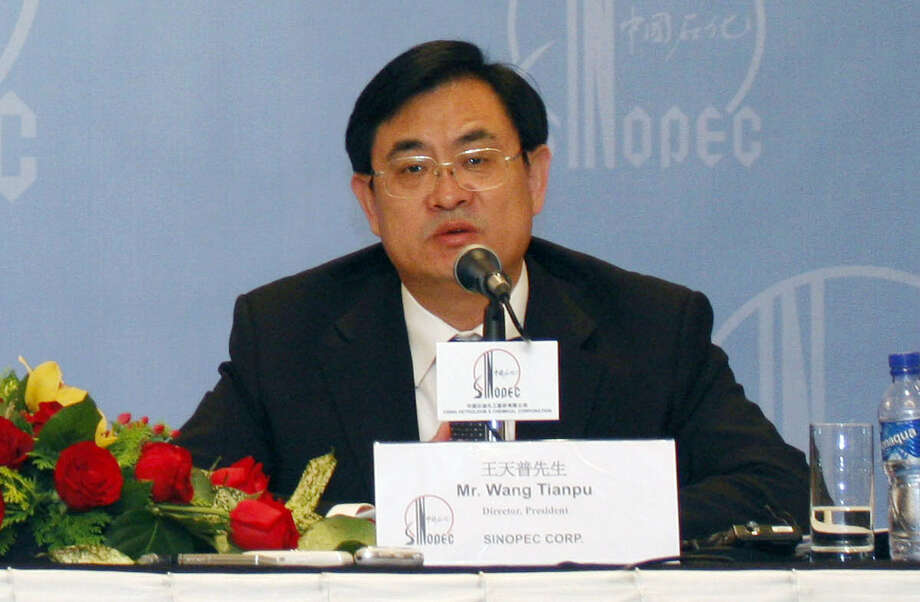 FILE - In this Monday, April 7, 2008 file photo, Sinopec President Wang Tianpu attends a news conference announcing the firm's annual results in Hong Kong. China's ruling Communist Party said Friday, Sept. 18, 2015, that it is stripping Wang, the former general manager of the country's largest oil refiner, of party membership and handing him over to prosecutors after an internal investigation found evidence of corruption. (AP Photo/Vincent Yu, File) Photo: VINCENT YU, STF / AP