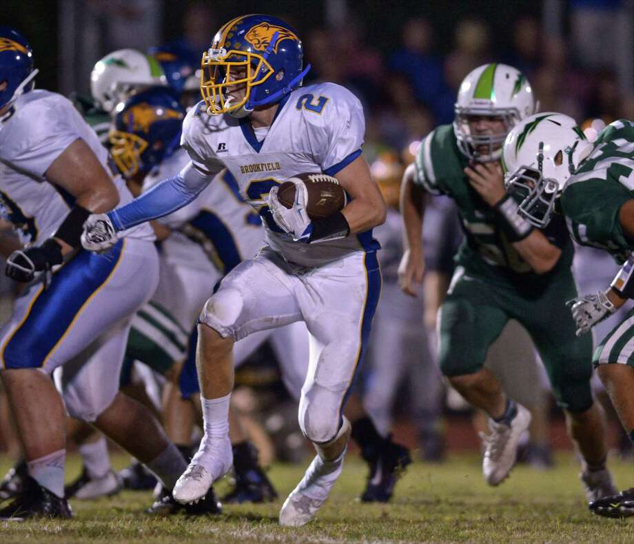 Brookfield's Andrew Collins (2) breaks through the line during the high school football game between Brookfield and New Milford high schools on Friday night, September 18, 2015, played at New Milford High School, in New Milford, Conn. Photo: H John Voorhees III / Hearst Connecticut Media / The News-Times