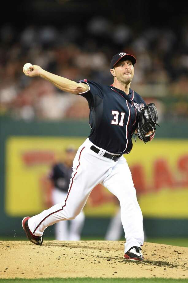 BALTIMORE, MD - SEPTEMBER 18:  Max Scherzer #31 of the Washington Nationals pitches in the third inning during a baseball game against the Miami Marlins at Nationals Park on September 18, 2015 in Washington,DC.  (Photo by Mitchell Layton/Getty Images) ORG XMIT: 538595075 Photo: Mitchell Layton / 2015 Getty Images