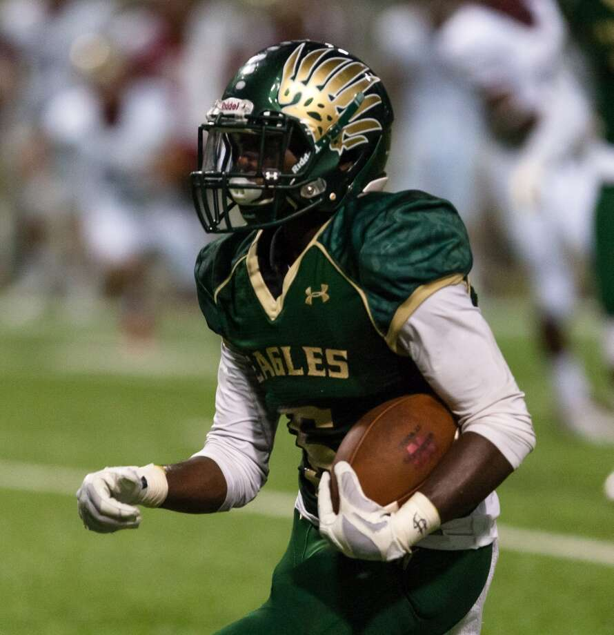 Cypress Falls Eagles RB Desmond Hite (6) running the ball for a touchdown during the second half of action between Cy Woods vs Cy Falls high schools during a football game at the Berry Center, Thursday, Sep. 17, 2015, in Spring. ( Juan DeLeon / For the Houston Chronicle ) Photo: Juan DeLeon, For The Chronicle