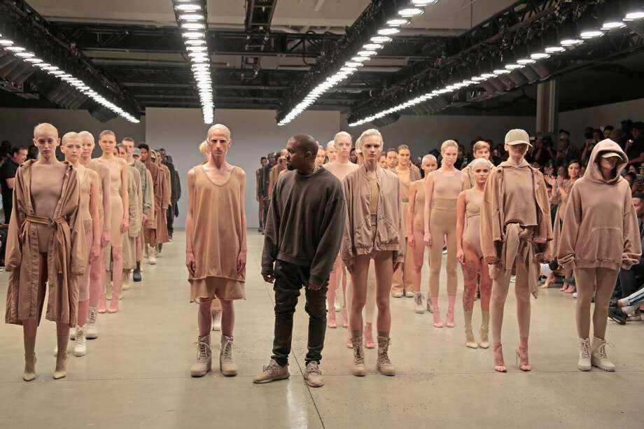 Kanye West poses during the finale of Yeezy Season 2 during New York Fashion Week. Photo: Randy Brooke
