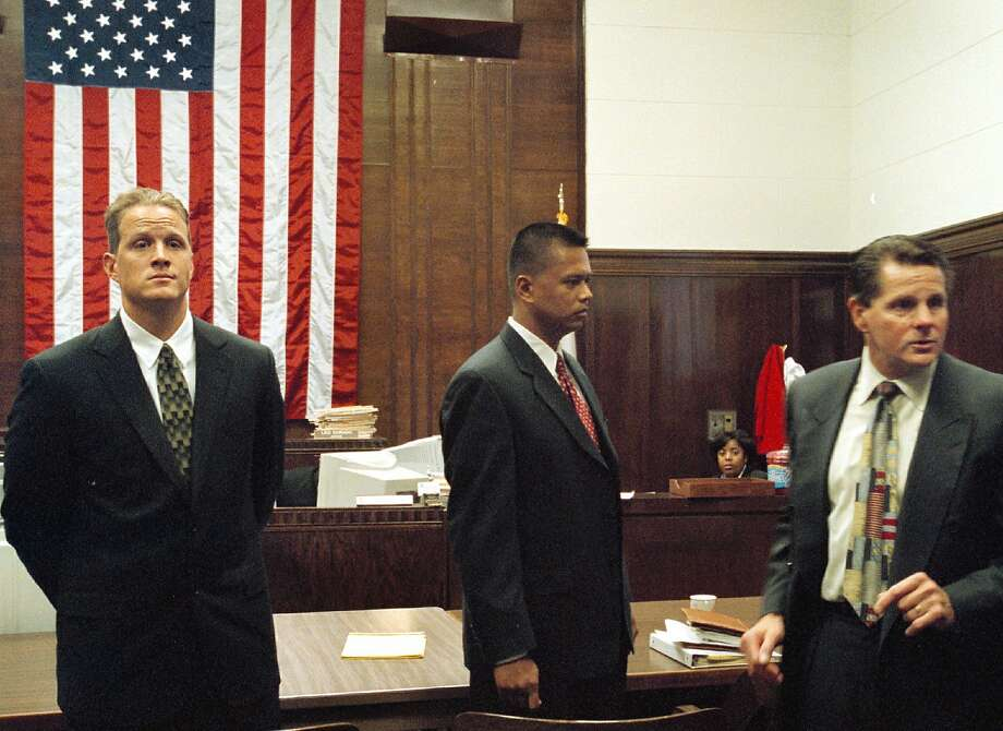 """Matthew Hornung (left) and Clarence """"Chuck"""" Mabanag (center), two of four former Oakland police officers known as The Riders, and defense attorney Michael Rains at Alameda County Superior Court in Oakland in 2002. Oakland has appointed a Chicago lawyer to head the newly created internal affairs division to oversee investigations into police as a result of the fallout from The Riders' case. Photo: Ray Chavez, AP"""