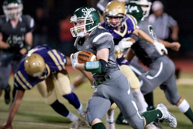 Shen's Griffin Wallner, center, returns the second-half kickoff for a 90-yard touchdown during their football game against CBA on Friday, Sept. 18, 2015, at Shenendehowa High in Clifton Park, N.Y. (Cindy Schultz / Times Union) Photo: Cindy Schultz / 00033403A