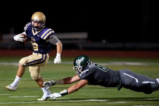 CBA's Nick DeNicola, left, avoids a tackle from  Shen's Michael Gillooley during their football game on Friday, Sept. 18, 2015, at Shenendehowa High in Clifton Park, N.Y. (Cindy Schultz / Times Union) Photo: Cindy Schultz / 00033403A