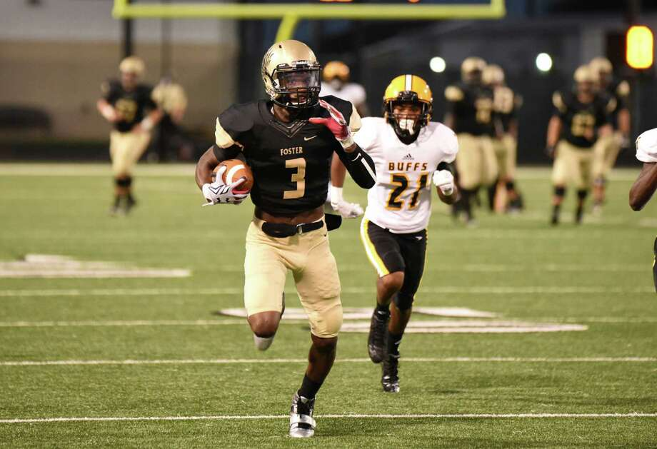 Foster receiver Cedarian Lamb takes off on a 72-yard touchdown reception in the first quarter Friday. Lamb was part of a potent offensive attack for the Falcons. Photo: Andrew Richardson, For The Chronicle / © 2015 Andrew Richardson