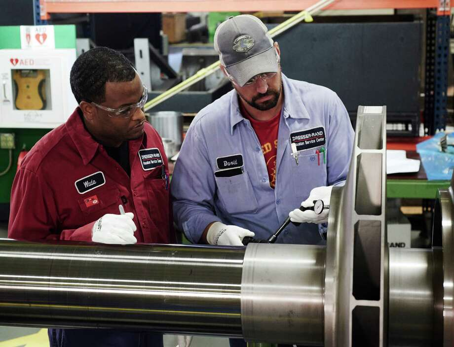 Dresser Rand Machinists Inspect A Compressor Rotor At The Company S Lumpkin Road Service Center In