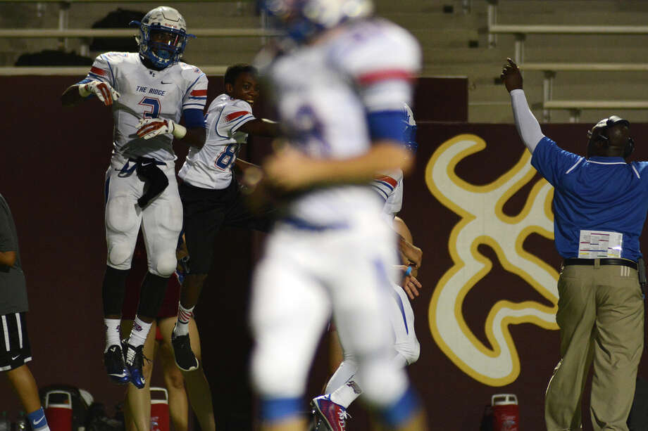 Oak Ridge wide receiver Kyle Townsend (3) celebrates after connecting on a touchdown pass with Braden Letney against Deer Park. Photo: Jerry Baker, Freelance