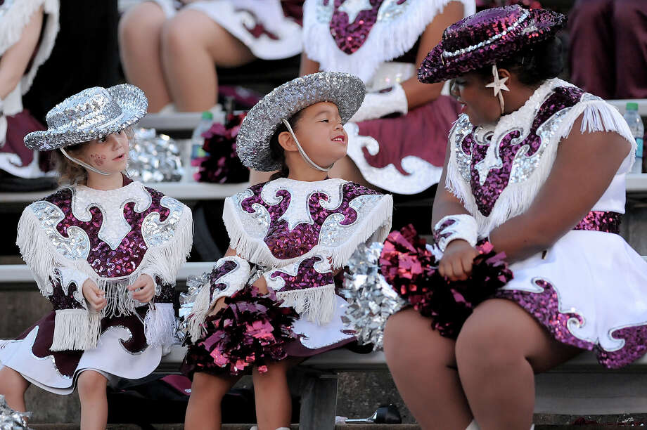 Silsbee Tigerette Mascots Madelynn Martinez and Zoei Palmer visit with Kennedi Gilder before the game against the West Orange-Stark Mustangs at Tiger Stadium September 18, 2015. Photo by Drew Loker Photo: Drew Loker / ©2015. www.DrewLoker.com