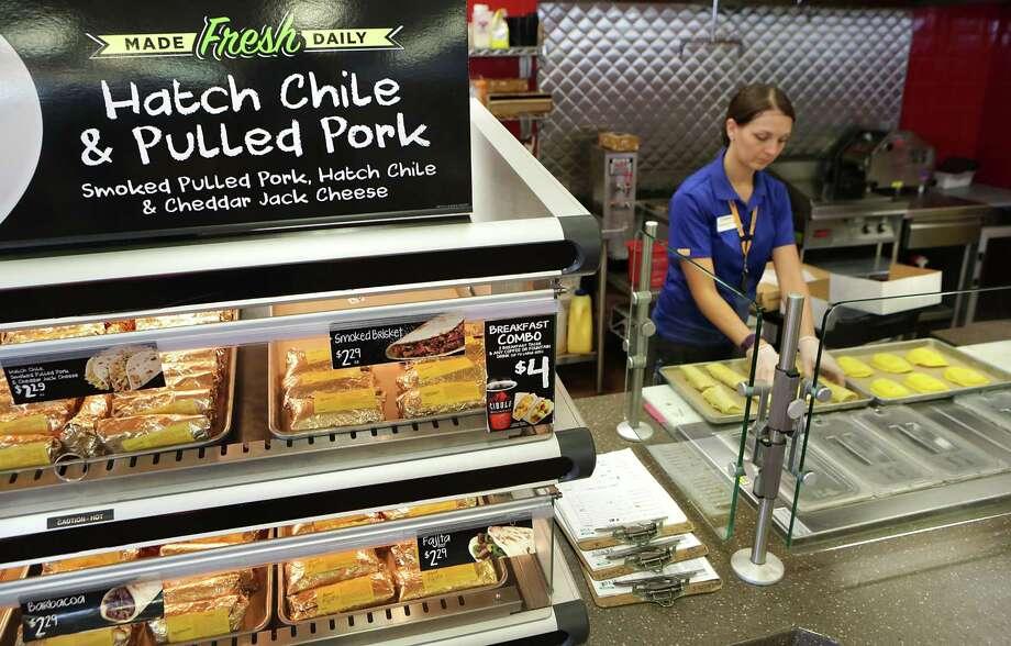 Samantha Baker, a manager of a Valero Corner Store in San Antonio, prepares to bake Jamaican Meat Pies. Photo: BOB OWEN / San Antonio Express-News