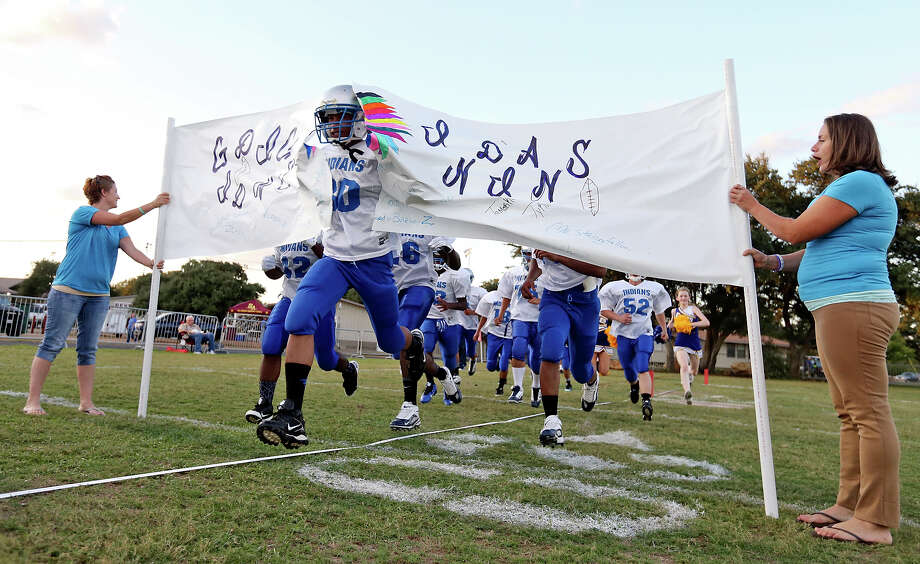 Members of the  Giddings Indians football team take the field before the game with the Castle Hills Eagles Friday Sept. 18, 2015 at Lion Pride Stadium. Photo: Edward A. Ornelas, Staff / San Antonio Express-News / © 2015 San Antonio Express-News