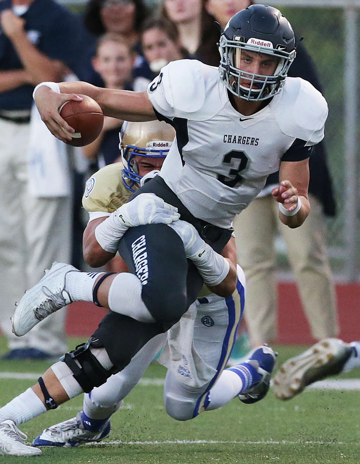 Chargers quarterback Josh Green stretches for more yardage as Alamo Heights hosts Boerne Champion at Orem Stadium on Sept. 18, 2015.
