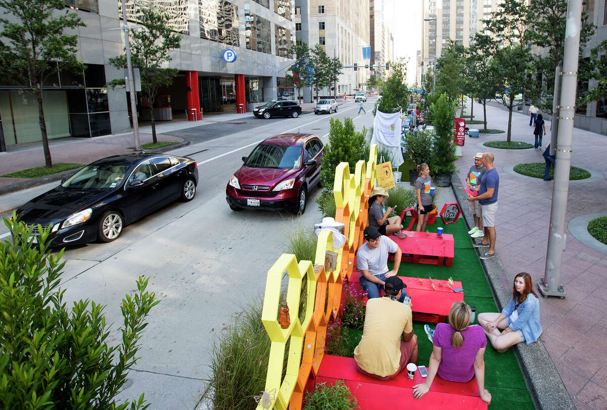 From PARK(ing) Day 2015: Members of the SWA Group sit in their converted parking space in downtown Houston.