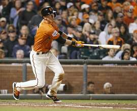 San Francisco Giants' Matt Duffy hits a single for a two-run RBI against the San Diego Padres during the seventh inning of a baseball game, Friday, Sept. 11, 2015, in San Francisco. (AP Photo/Tony Avelar)