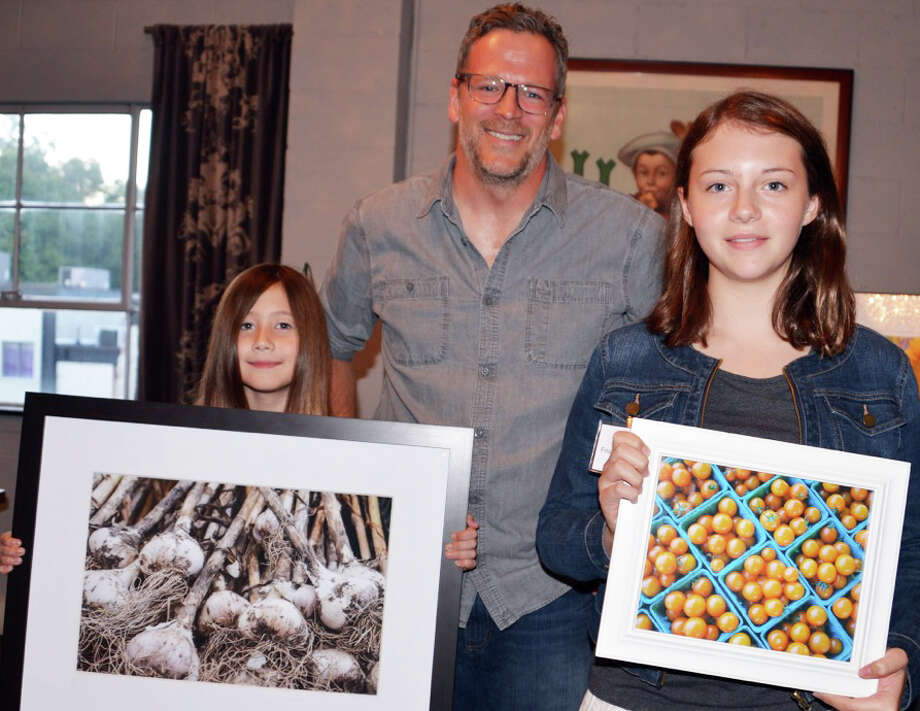 Young Shoots photo contest first-place winners, Esme Stiel, left, in the 8 to 10-year-old category and Lili Dowell, first-place in in the 11 to 14-year-old category, with Bill Taibe, owner of The Whelk restaurant, where the winners will co-lead a photo shoot as one of their prizes. Photo: Contributed / Contributed Photo / Westport News