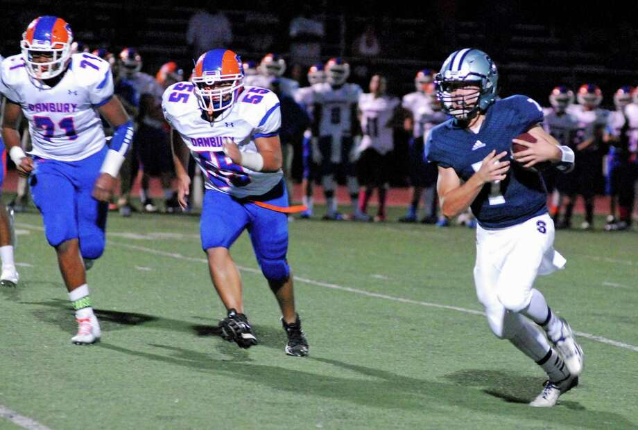 Staples quarterback Andrew Speed, right, carries the ball during the Wreckers' 21-14 win over Danbury on Friday, Sept. 18 2015 at Staples High School in Westport, Connecticut. Photo: Ryan Lacey/Staff Photo / Westport News Contributed