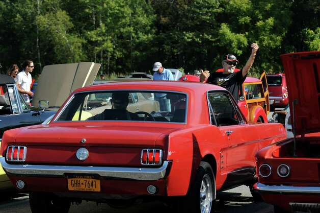 Volunteer Ron Montana, right, assists with parking a 1965 Ford Mustang during the 5th annual Times Union Car show to benefit the Hope Fund on Saturday, Sept. 19, 2015, at the Times Union in Colonie, N.Y. (Cindy Schultz / Times Union) Photo: Cindy Schultz / 00033392A3