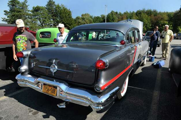 Car enthusiasts look over a 1956 Oldsmobile during the 5th annual Times Union Car show to benefit the Hope Fund on Saturday, Sept. 19, 2015, at the Times Union in Colonie, N.Y. (Cindy Schultz / Times Union) Photo: Cindy Schultz / 00033392A3