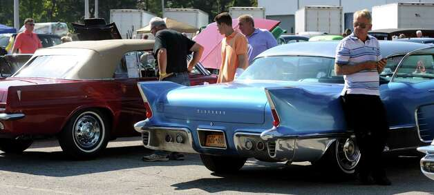 Car enthusiasts check out the classic cars during the 5th annual Times Union Car show to benefit the Hope Fund on Saturday, Sept. 19, 2015, at the Times Union in Colonie, N.Y. (Cindy Schultz / Times Union) Photo: Cindy Schultz / 00033392A3