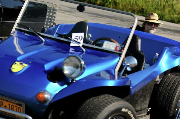 Emile Catricala of Colonie sits with his 1968 California Clipper, a Volkswagen dune buggy, during the 5th annual Times Union Car show to benefit the Hope Fund on Saturday, Sept. 19, 2015, at the Times Union in Colonie, N.Y.  (Cindy Schultz / Times Union) Photo: Cindy Schultz / 00033392A3