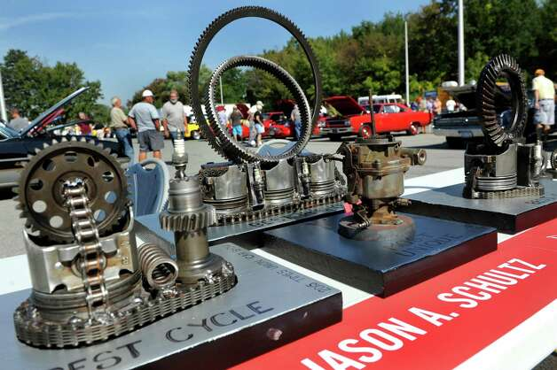 """Billed as """"the area's most unique trophies,"""" winning car and motorcycle trophies, made by local artist Jason Schultz, are on display during the 5th annual Times Union Car show to benefit the Hope Fund on Saturday, Sept. 19, 2015, at the Times Union in Colonie, N.Y.  (Cindy Schultz / Times Union) Photo: Cindy Schultz / 00033392A3"""