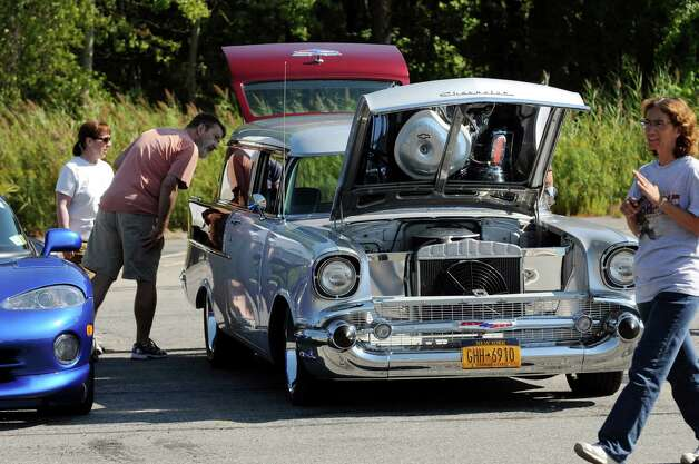 Car enthusiasts look over a classic Chevrolet during the 5th annual Times Union Car show to benefit the Hope Fund on Saturday, Sept. 19, 2015, at the Times Union in Colonie, N.Y. (Cindy Schultz / Times Union) Photo: Cindy Schultz / 00033392A3