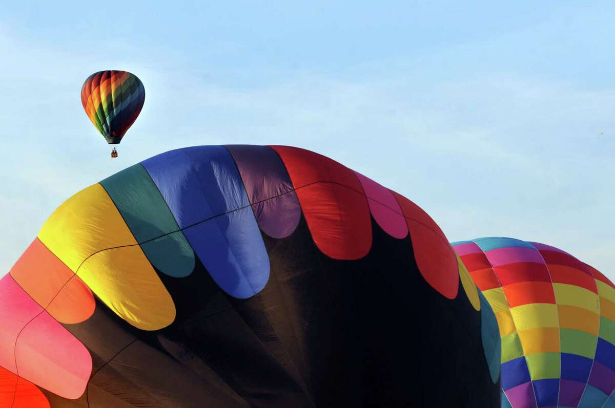 Hot air balloons lift off during the Adirondack Balloon Festival on Friday, Sept. 18, 2015, at Floyd Bennett Memorial Airport in Queensbury, N.Y. Flight times are 6:30 a.m. and 5 p.m. on Saturday and Sunday.(Cindy Schultz / Times Union)