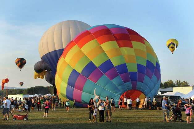 Hot air balloons take to the skies during the Adirondack Balloon Festival on Friday, Sept. 18, 2015, at Floyd Bennett Memorial Airport in Queensbury, N.Y. Flight times are 6:30 a.m. and 5 p.m. on Saturday and Sunday.(Cindy Schultz / Times Union) Photo: Cindy Schultz / 00033270A