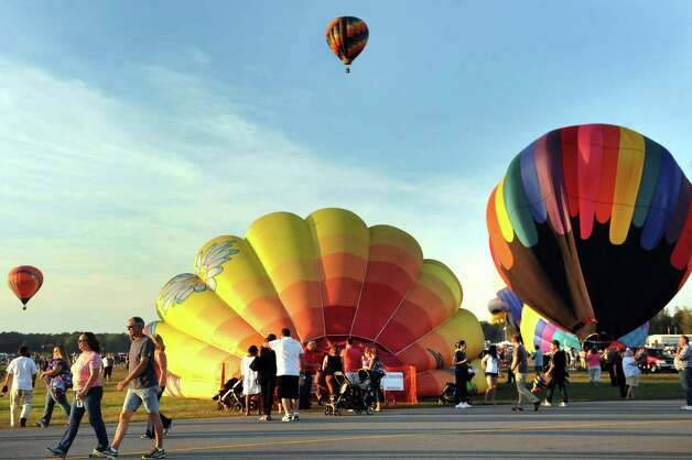 Hot air balloons prepare for flight during the Adirondack Balloon Festival on Friday, Sept. 18, 2015, at Floyd Bennett Memorial Airport in Queensbury, N.Y. Flight times are 6:30 a.m. and 5 p.m. on Saturday and Sunday.(Cindy Schultz / Times Union) Photo: Cindy Schultz / 00033270A