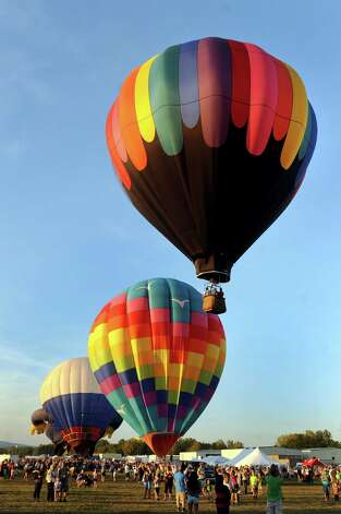 Hot air balloons lift off during the Adirondack Balloon Festival on Friday, Sept. 18, 2015, at Floyd Bennett Memorial Airport in Queensbury, N.Y. Flight times are 6:30 a.m. and 5 p.m. on Saturday and Sunday.(Cindy Schultz / Times Union) Photo: Cindy Schultz / 00033270A