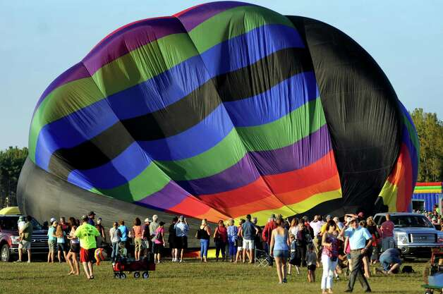 A hot air balloon is filled with air during the Adirondack Balloon Festival on Friday, Sept. 18, 2015, at Floyd Bennett Memorial Airport in Queensbury, N.Y. Flight times are 6:30 a.m. and 5 p.m. on Saturday and Sunday.(Cindy Schultz / Times Union) Photo: Cindy Schultz / 00033270A