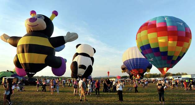 Hot air balloons take flight during the Adirondack Balloon Festival on Friday, Sept. 18, 2015, at Floyd Bennett Memorial Airport in Queensbury, N.Y. Flight times are 6:30 a.m. and 5 p.m. on Saturday and Sunday.(Cindy Schultz / Times Union) Photo: Cindy Schultz / 00033270A