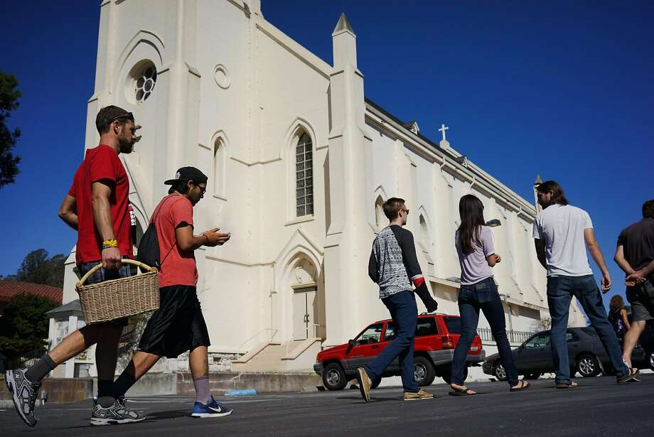 Greg Cotten, left, and Kagen Holland, second from left, walk to the parking lot of Holy Cross Church where a mass grave for Native Americans is in Santa Cruz, Calif. on Saturday Sept. 19, 2015. Tataviam descendants Caroline Ward Holland and Kagen Holland are leading the Walk for the Ancestors which will visit every mission in protest of the canonization of Junipero Serra. Photo: James Tensuan, Special To The Chronicle