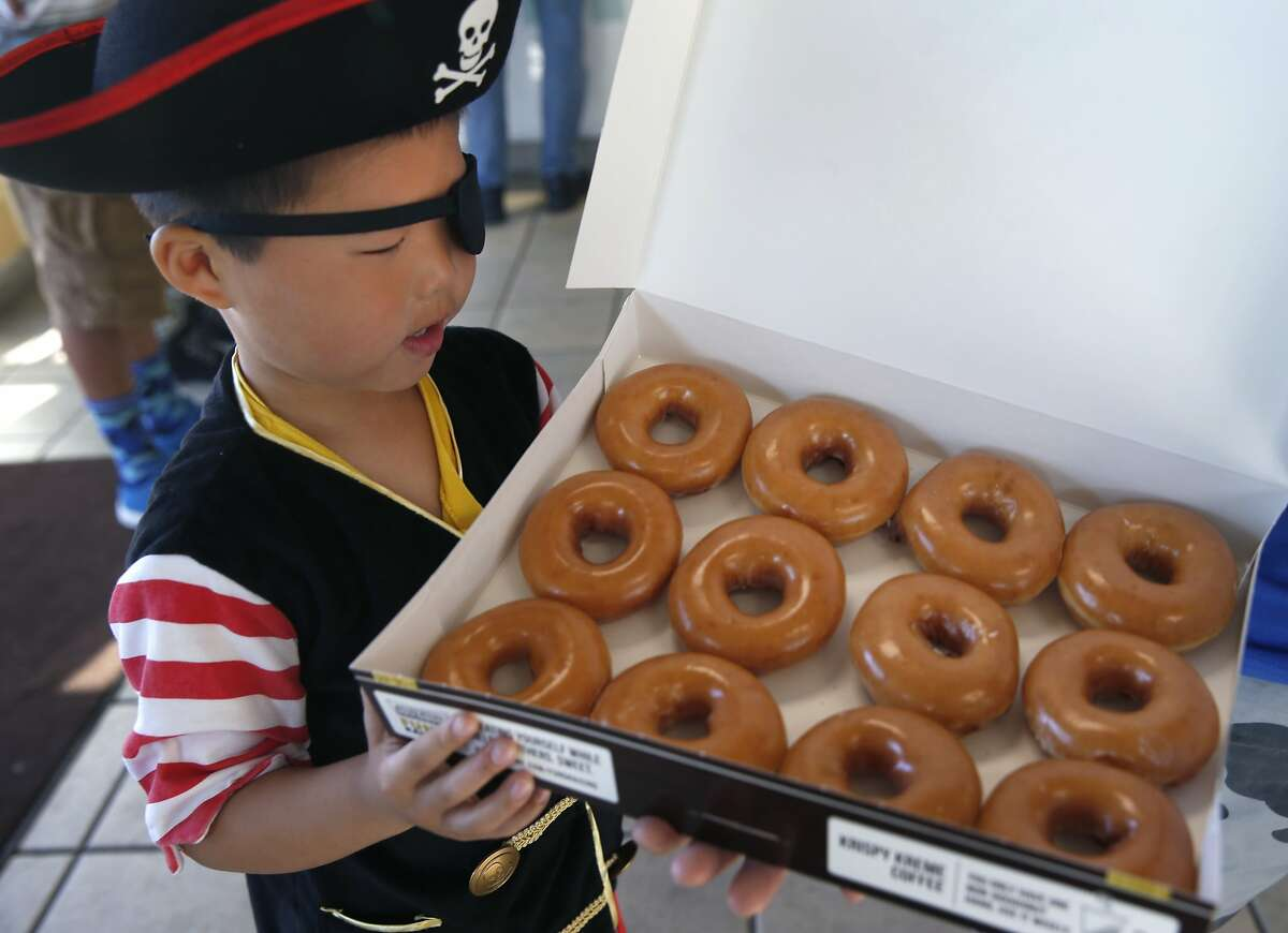 Tyler Quan, 5, admires his booty of doughnuts at the Krispy Kreme in Daly City, Calif. on Saturday, Sept. 19, 2015. Any customer dressed with three or more pirate items received a dozen Krispy Kreme doughnuts for free to celebrate International Talk Like A Pirate Day and anyone who simply talked like a pirate received a single doughnut for free.