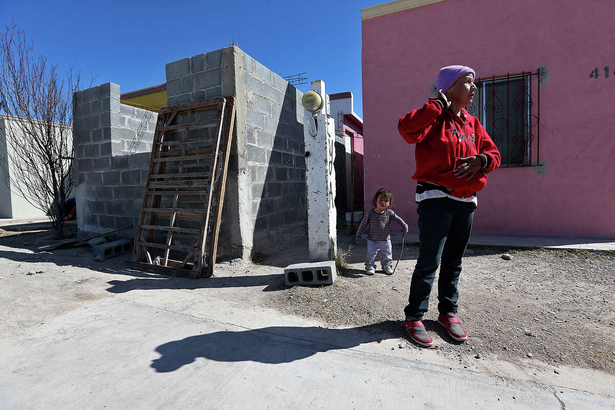 Ana Maria Sandoval talks about her son outside her house in Allende, Mexico, Tuesday, Jan. 27, 2015. Allende is a small town southwest of Piedras Negras, Mexico and is the site of a massacre by the drug cartel, Los Zetas. It is estimated that over 300 went missing or killed in March of 2011. Her son, Jose Willivaldo Martinez Sandoval, 21, was one of those and was taken from his house by armed men on March 5, 2011.