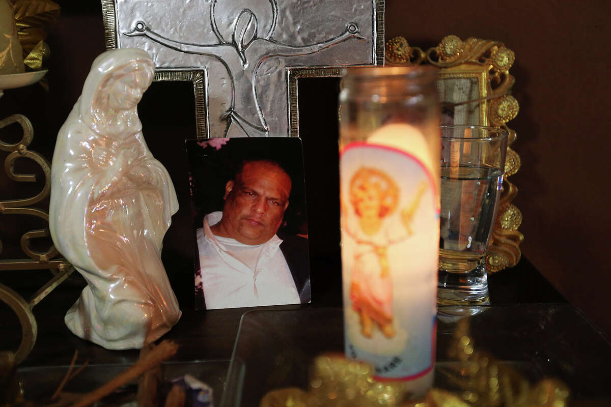 Maria Hortencia Rivas Rodriguez keeps a candle for her son, Victor Manuel Guajardo Rivas, at her house in Piedras Negras, Mexico, Tuesday, Jan. 27, 2015. Her son went missing on July 10, 2013. Men dressed as GATE's, a special tactical force of the Coahuila state government, took him from his house on that night. He was 37-years-old when he went missing and is one of 1,400 missing in the state of Coahuila.