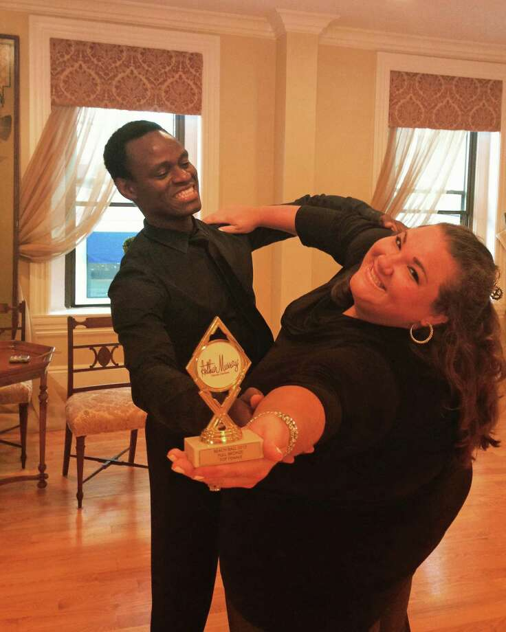 Greenwich resident Melissa Vitti and Ricardo Sopin, an instructor at the Arthur Murray Dance Center in Greenwich, show off the trophy they won earlier this month at the Arthur Murray Beach Ball Competition in New London. Photo: Contributed / Contributed Photo / Greenwich Time Contributed
