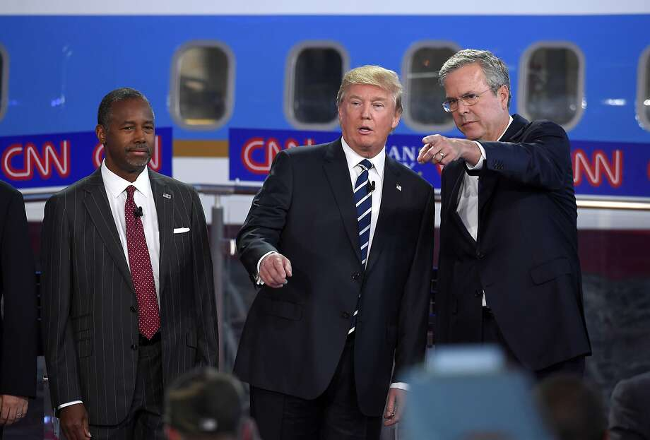 Presidential candidates Ben Carson (left) and Donald Trump have made statements that complicate Republican efforts to reach out to minority voters. Jeb Bush (right) has disavowed some of that rhetoric. Photo: Mark J. Terrill, Associated Press